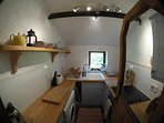Lovely small kitchen-wooden worktops, ceramic sink, fridge, WM, halogen hob+oven+view to garden...