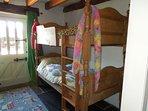 one of the bunkbeds in the children's room