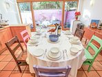 Large kitchen/diner with seating for 8. Kitchen leads onto secluded court yard.