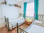 Twin bedroom, spacious and bright.