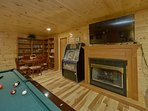 Game room with 55' Smart TV, billiards, juke box, game table and more