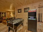 Game room with arcade and foosball