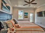 King bedroom #23 opens to balcony with views to beach, private bathroom, wall-mounted TV