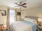 Queen size bed with comfortable mattress in this 2nd floor bedroom with room darkening shades.