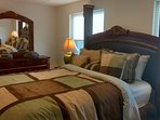 Lower Level Queen Bedroom with waterfront and pool views.