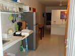 Kitchen with all essentials for cooking meals. Full refrigerator