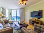 Relax in the comfortable family room with new leather furniture, flat screen TV with sound bar.