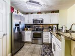 Updated kitchen with granite counters, stainless appliances and special lighting. Fully equipped.