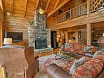 Turn on the flat-screen satellite TV & enjoy the warmth of the fireplace.