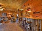 The terrace level houses a custom pine bar.