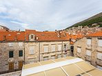 Unobstructed views over the city's red roofs and the majestic city walls!