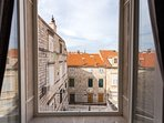 Large windows allowing the natural light and the beautiful views of Dubrovnik red roofs to come in