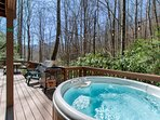 hot tub and grill on open back deck over the creek