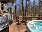 hot tub and grill at back of the cabin