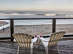 Overlooking sand and surf with beach only a few steps from your door