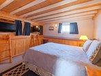 Queen bedroom with caboose bed