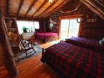 Our second floor loft offers additional sleeping with a queen and 2 more twin beds.