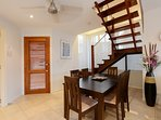 Dinning area with front door and stairs to bedrooms