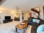 Open plan design with large flat screen TV
