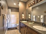 You'll love the ample counter space and shower/tub combo in this bathroom.