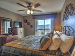 The master bedroom offers a king-sized bed and balcony access.