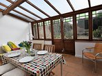 Enjoy dinner in the light and airy conservatory