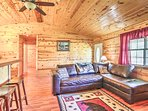 Wood beam walls and vaulted ceilings create a warm and rustic atmosphere inside.