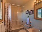 This en-suite bathroom has a shower/tub combo.