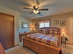 Bedroom 1 offers a queen bed and ample closet space.