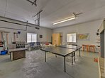 The garage game room has a ping pong table, darts and ample seating!