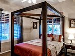 The fourth bedroom also hosts a queen bed.