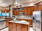 The fully equipped kitchen hosts stainless steel appliances.
