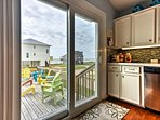 Pass through the sliding glass doors to lounge on the deck.