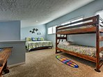 This bunk room features 2 bunks and a king bed.