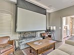 Utilize the projection screen for the perfect at-home movie night.