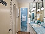 Blue tiled counters and walls adorn the en-suite bathroom.