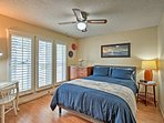 The third bedroom houses a plush queen bed.
