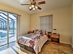 This bedroom with a queen bed includes private patio access.