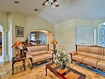 Classic decor and leather furnishing highlight the formal living room.