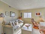 With elegant coastal decor, the condo boasts beauty and personality.