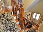 The elegant front hall staircase.