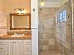 Second floor full bathroom with glass walk-in shower.