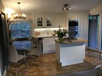 Beautifully fitted kitchen and dining area with quality fittings and fitments throughout
