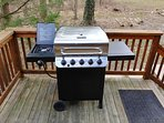 Gas grill conveniently located just outside the dining kitchen sliding glass doors.