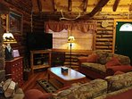 Wonderful spot in our cabin to curl up and watch a movie, read a book or enjoy our fireplace.