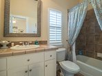 The 3rd level Guest Queen Bedroom offers an En Suite Bath with ceramic tile & a tub/shower combo