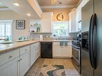 The beautiful kitchen has upgraded stainless steel appliances and tons of counter space