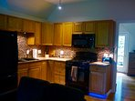 A lovely, stocked, kitchen w/full sized appliances, and tiled backsplash at Treetop-Retreat.