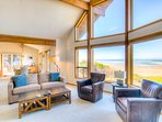 Ocean front views and vaulted ceiling in the living room.