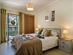 The Master bedroom with warm and inviting kingsize bed